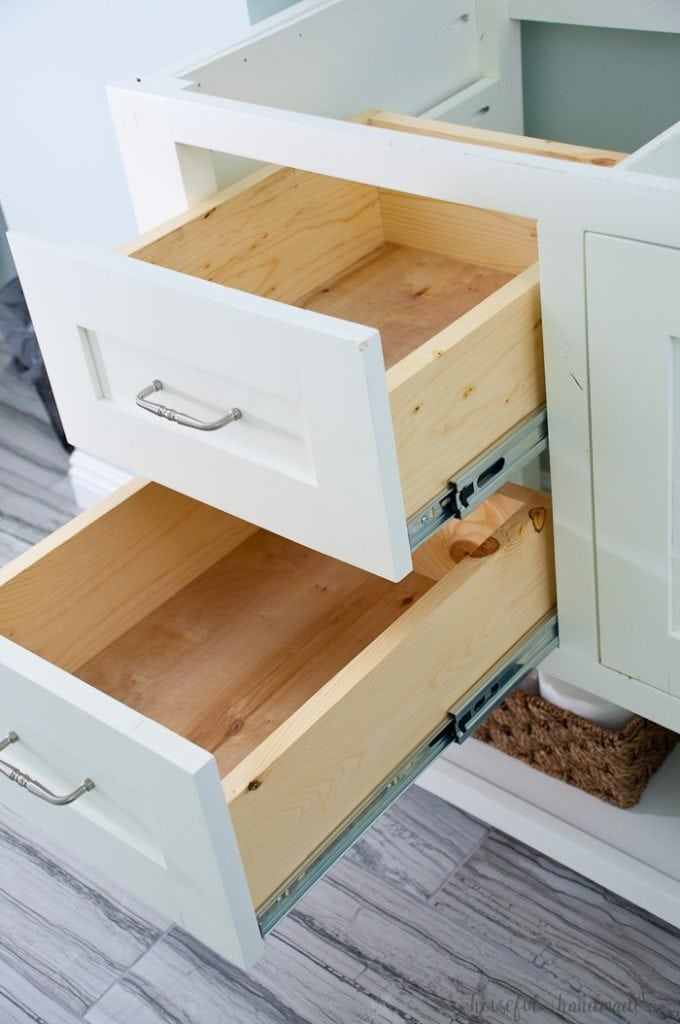 With a little bit of woodworking experience you can build your own bathroom vanity. Build an 8' double vanity for less than $300 for a budget friendly DIY renovation. Get the free plans for this mission style open shelf bathroom vanity from Housefulofhandmade.com