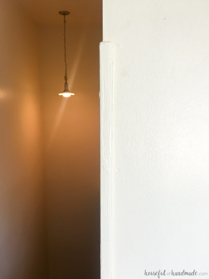 hall stairway shown with hanging light