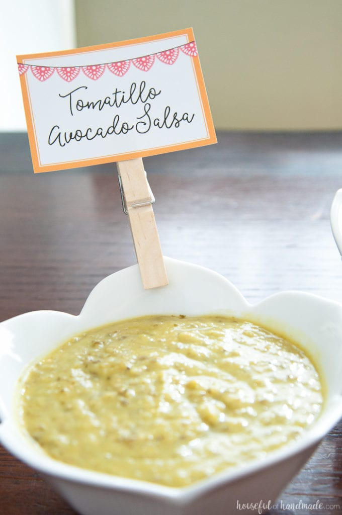 custom sign labeling tomatillo avocado salsa on a table at a Salsa & Margaritas Adult Birthday Party