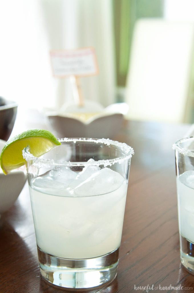 spicy jalepeno margarita with lime on a table with salsa at a Salsa & Margaritas Adult Birthday Party