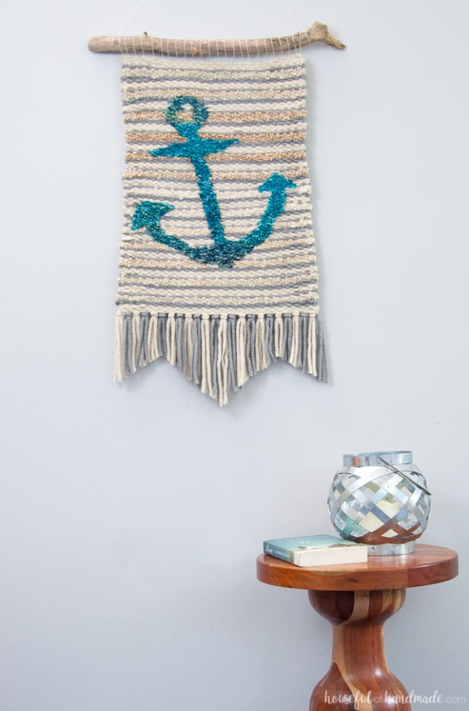 Create beautiful textured art for your walls with a DIY weaving. I decided to try out weaving for the first time and am sharing what I learned while making a Woven Anchor Wall Hanging. It was so much fun, I am already planning on a second project. | Housefulofhandmade.com