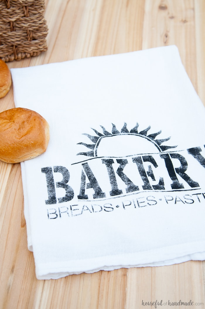 I want to make a bunch of these tea towels for gifts! These easy to make DIY bakery tea towels are a great way to add vintage charm to your kitchen or to give as gifts. Learn how to make a plastic stencil with your Silhouette to paint on inexpensive store bought flour sack towels.   Housefulofhandmade.com