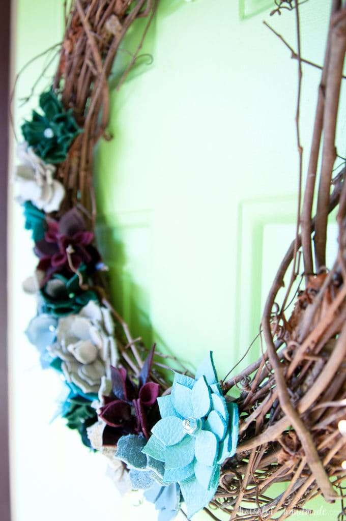 This wreath is so beautiful! I love the leather faux succulents. Use colorful pieces of leather and nuts & bolts to make a rustic industrial DIY leather succulent wreath. | Housefulofhandmade.com