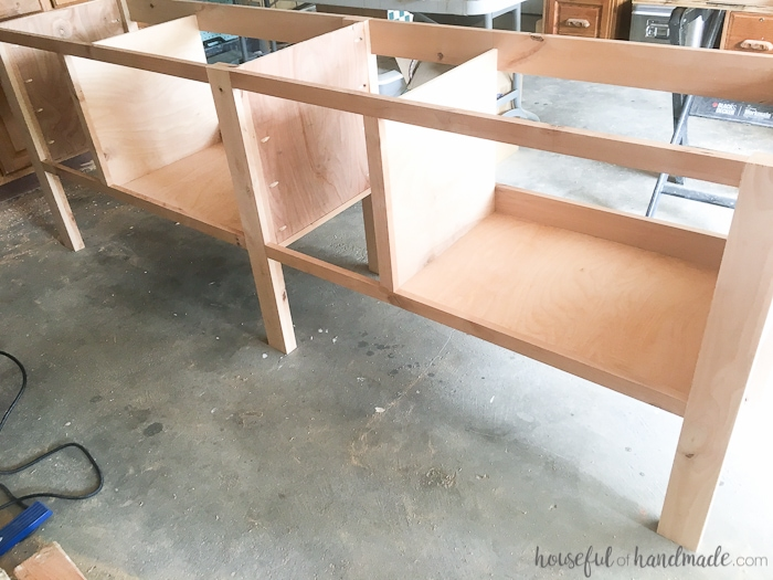 Picture of the double vanity in the process of being built with knotty alder wood and plywood.