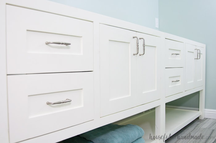 Full picture of the installed double sink bathroom vanity with a smooth professional paint finish on it.