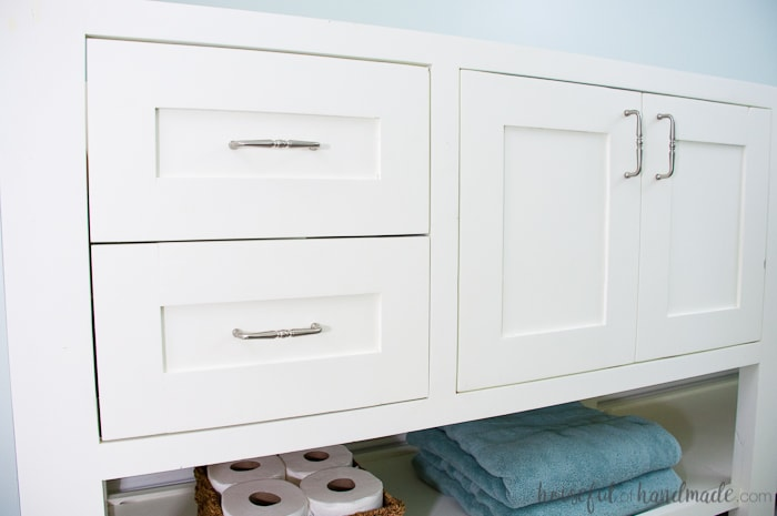 White mission style vanity with smooth professional paint finish on it.