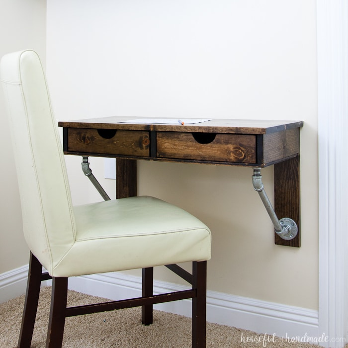Use these amazing DIYs to Organize your home this year. Create the perfect homework space with this easy to build desk. This easy rustic industrial wall-mounted desk can be added in any small space. Get the free build plans today! | Housefulofhandmade.com