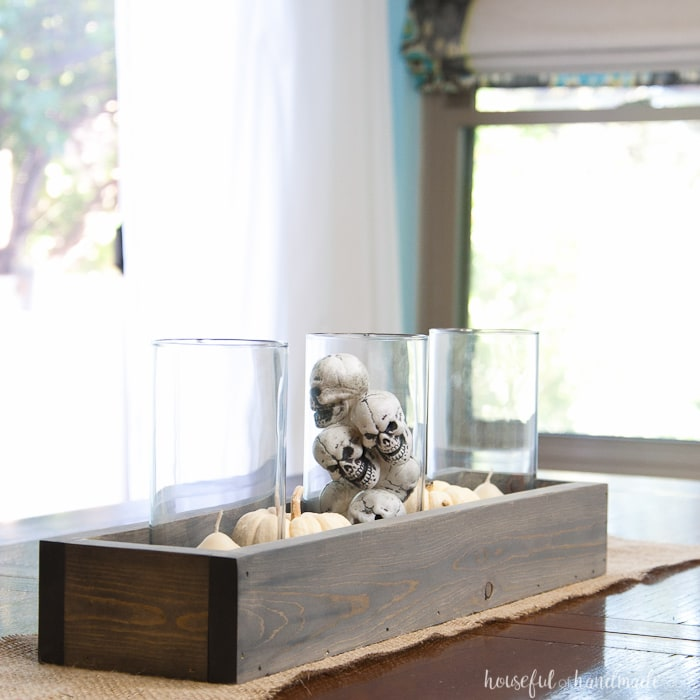 This is the perfect combination of spooky and farmhouse decor. Decorate your dining room table with this easy DIY Halloween centerpiece. Includes a tutorial to make a wooden trough box in minutes. | Housefulofhandmade.com