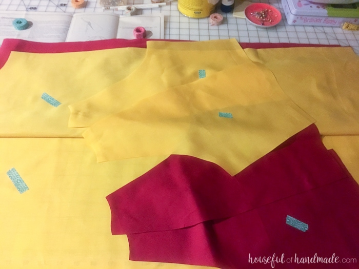 I want this costume for myself! Turn a simple robe pattern into a Harry Potter Quidditch Robes halloween costume with a couple easy adjustments. Also make your own Gryffindor house patch, arm and leg pads, and a Nimbus 2000 so you are ready for the big game. | Housefulofhandmade.com
