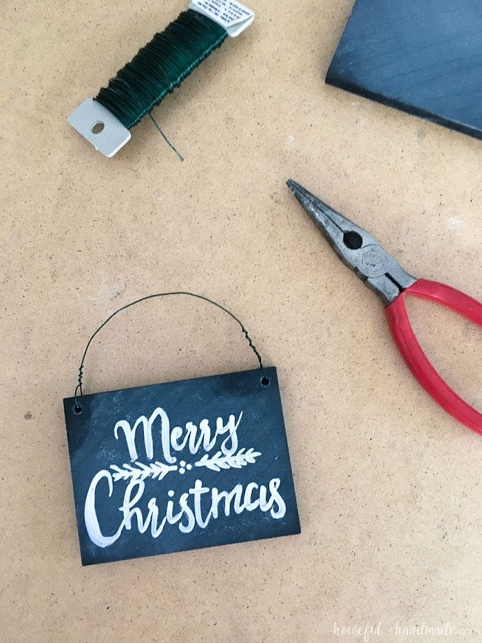 These Christmas ornaments are perfect for my rustic decor! Learn how to make these DIY chalkboard sign ornaments with just a few simple steps. They are perfect for a farmhouse style Christmas or to gift to friends and family.   Housefulofhandmade.com