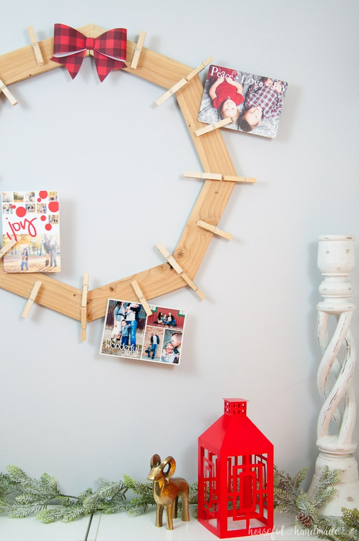 DIY wood Christmas card wreath from 1 1x3 board shown hanging on all with photo cards.