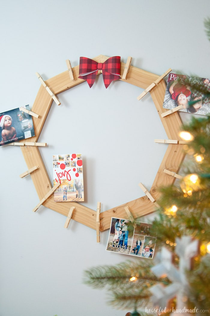 DIY wood Christmas card wreath displayed with cards