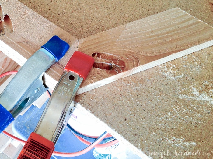 clamps shown holding diy wood christmas card wreath