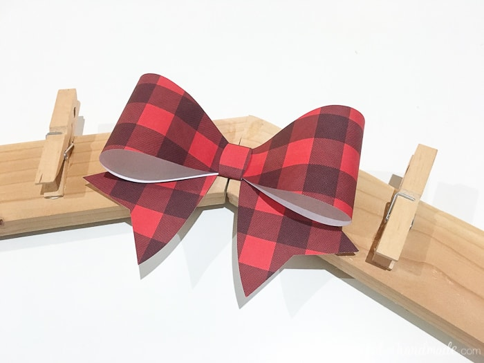 buffalo check bow shown on diy christmas card wreath holder