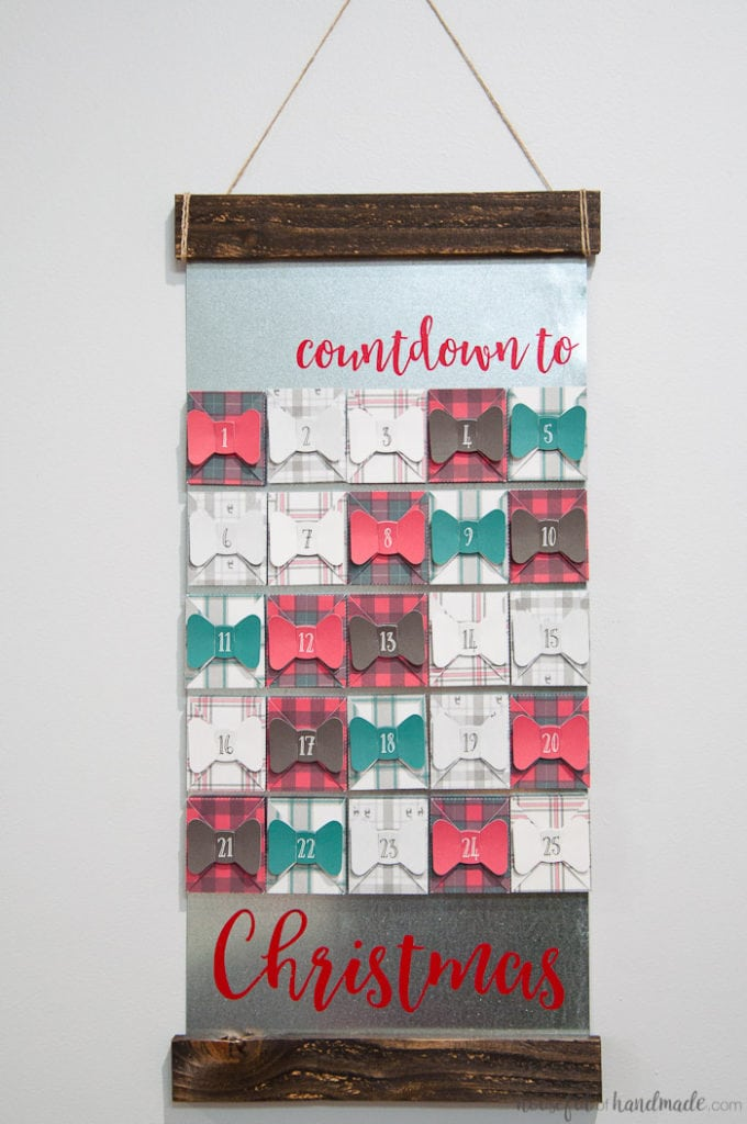 I absolutely love this farmhouse style advent calendar! If you love buffalo check and tartan plaid this is the advent calendar for you. Make 25 plaid boxes, sealed with a bow, to hold a surprise or activity for every day in December until Christmas. Get all the details for how to make a farmhouse plaid Christmas advent calendar today! | Housefulofhandmade.com