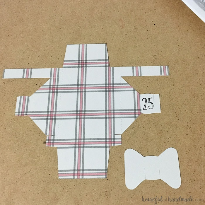 cut out of plaid box with bow for advent calendar.