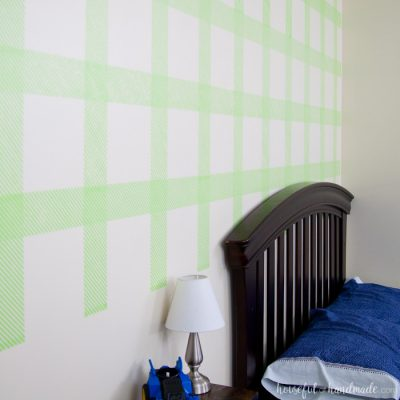 Create an awesome feature wall for your boy's room with this DIY plaid wall. Learn how to make your own stencil and paint it with all these great stencil tips & tricks. | Housefulofhandmade.com
