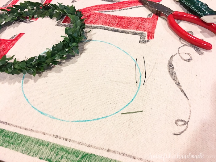 close up of garland being added to letter o in Noel
