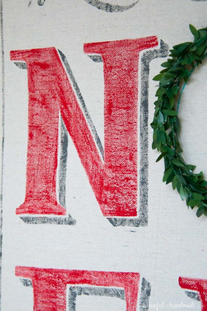 close up of painted N in noel Christmas sign