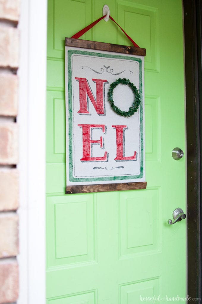 Noel Vintage Scroll hanging on bright green door