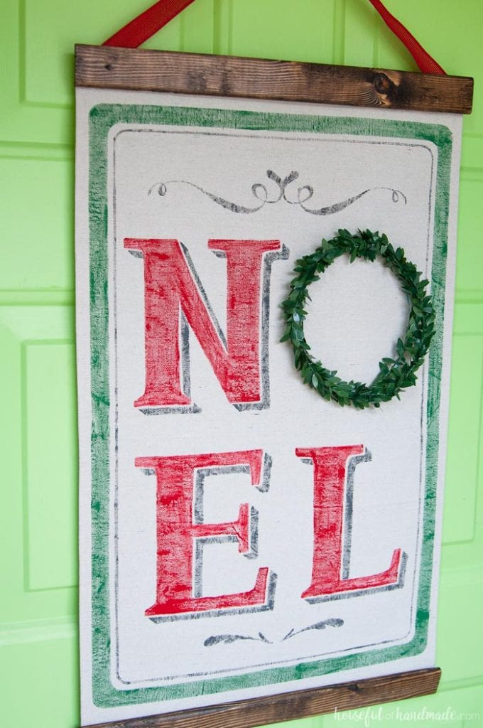 noel scroll hanging on door