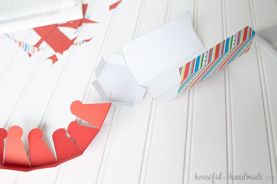 Pieces of the cookie boxes cut out of patterned cardstock and folded along the dotted lines.