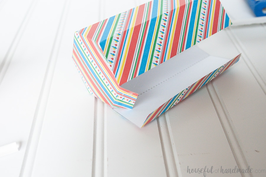 Showing the cookie gift box will almost all the tabs glued together on the bottom.