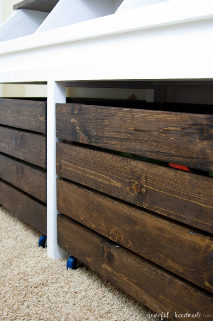 close up of the rolling storage boxes of the diy rustic toy box