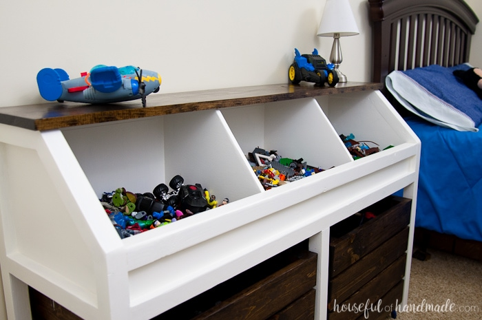 toy storage unit with bed in back round