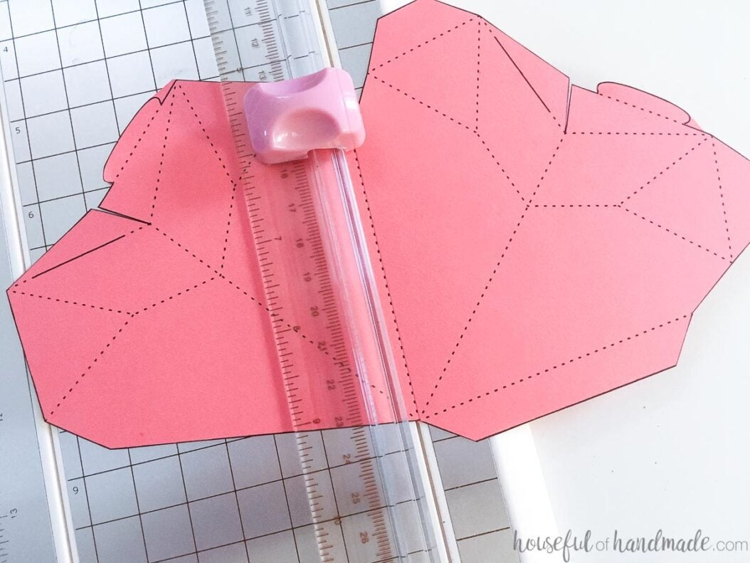 Scoring the dotted lines of the heart template with a paper scorer.