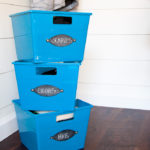 Blue bins in the entryway organized with chalkboard labels.