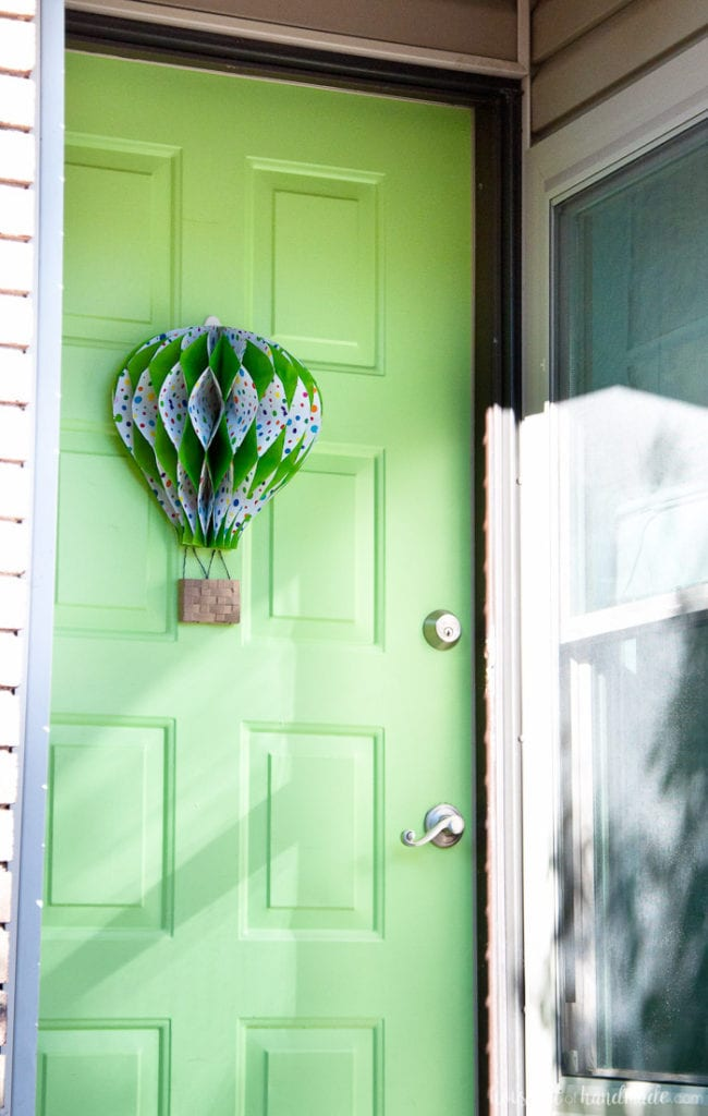 Make a paper hot air balloon spring wreath to brighten up your front door this spring! Housefulofhandmade.com | Unique wreath ideas | Spring Wreath | Summer Wreath | Paper Crafting | DIY Hot Air Balloon | Paper Decor | DIY Wreath