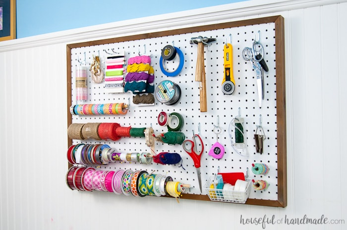 Use these amazing DIYs to Organize your home this year. Create the perfect place to organize your most used supplies! Learn how to hang pegboard so it is removable if needed. Housefulofhandmade.com | Craft organization ideas | Craft room remodel | Pegboard organization | $100 Room Challenge | Easy woodworking | Easy building plans | Free Building plans