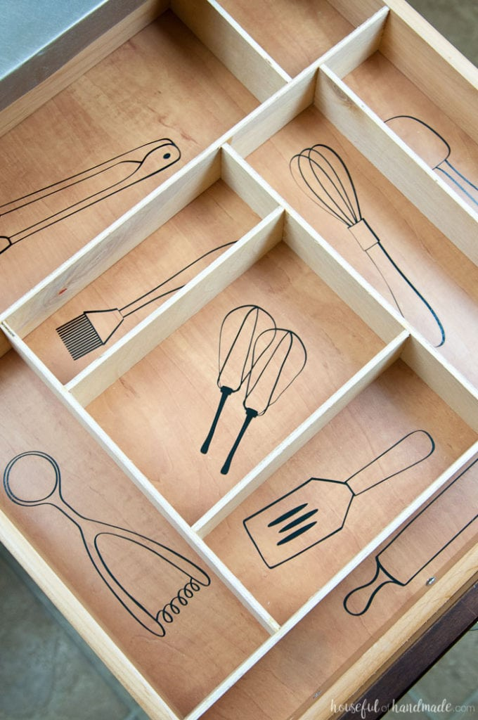 Kitchen drawers organized with vinyl labels that look like the kitchen utensils.