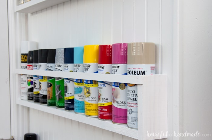 Create the perfect DIY paint storage from scraps or cheap wood. The paint storage shelves can even be hung in closets or behind doors to free up even more space. Housefulofhandamde.com | $100 Room Challenge | Spray Paint Storage | Craft Paint Storage | Craft Room Organization | Scrap Wood Build Plans | Free Build Plans | DIY Storage Solutions | Craft Room Makeover | Office Makeover