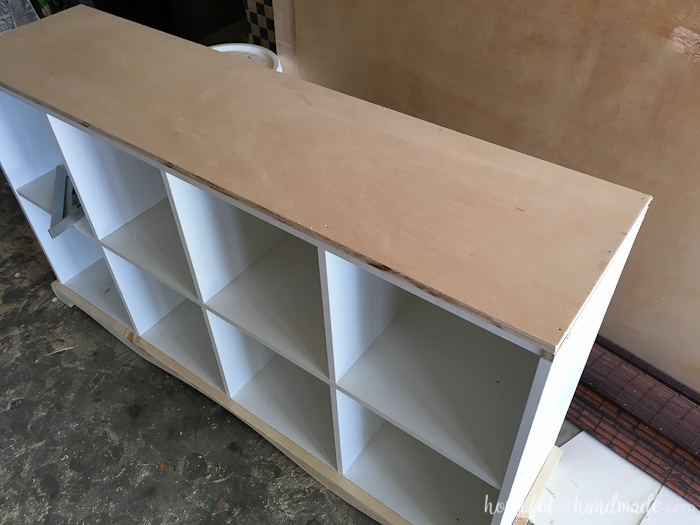 Adding the top to the of the diy cubicle bookcase