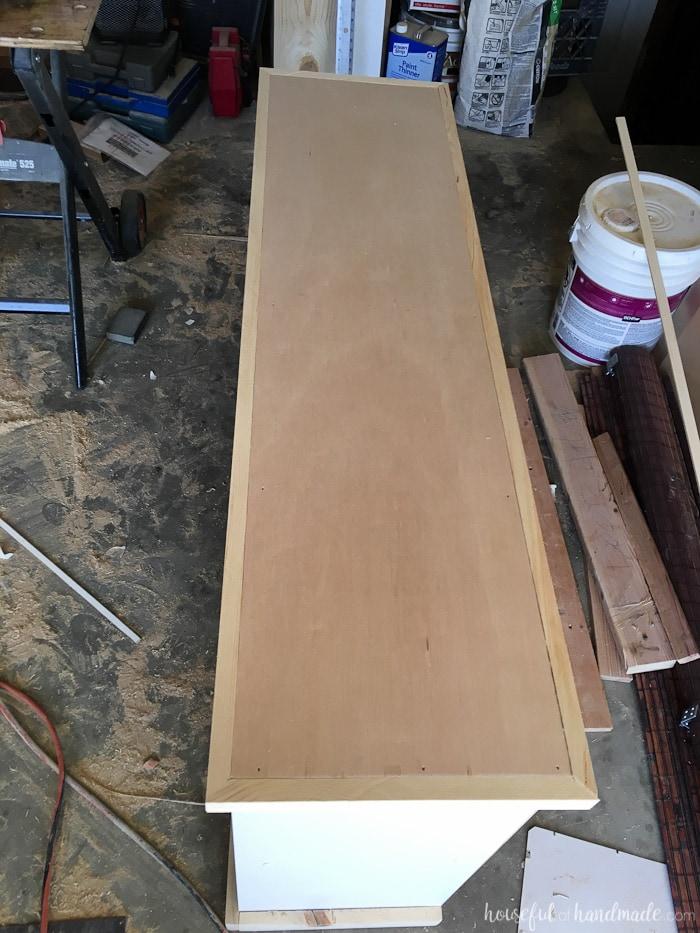 adding trim to the farmhouse bookcase