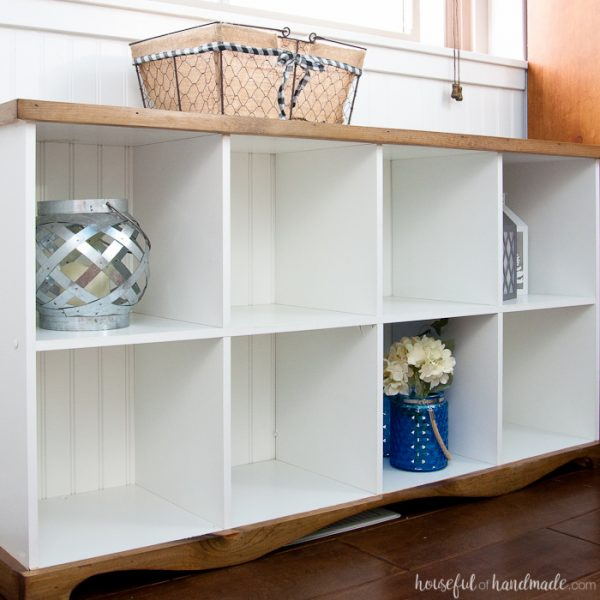 Don't throw out those old melamine bookcases. Create a beautiful farmhouse console table DIY from an upcycled cube bookcase. An easy and inexpensive DIY. Housefulofhandmade.com | Farmhouse Bookcase | Free Build Plans | DIY Console Table | Upcycled Bookcase | Cube Bookcase Storage | Budget Makeover | $100 Room Challenge
