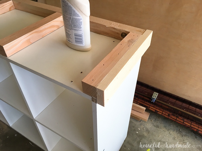 Putting on the base of the diy cube bookcase
