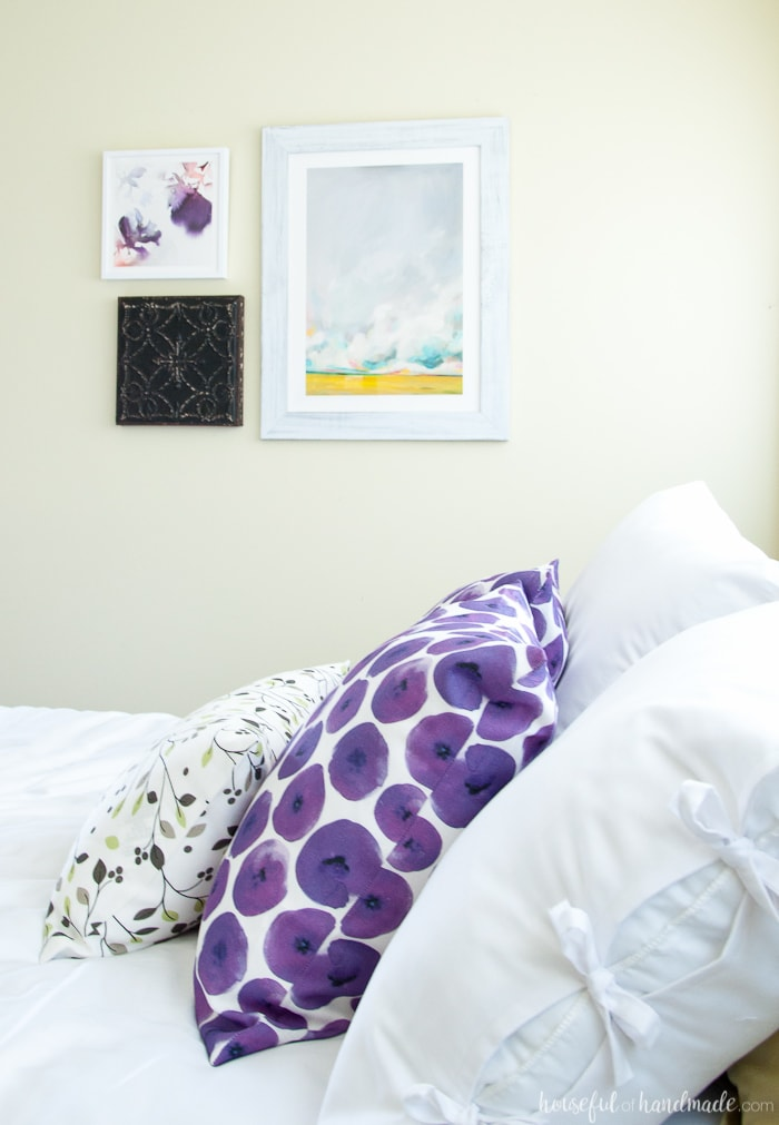 See how easy it is to complete a Master Bedroom Makeover in a weekend. A handful of simple projects can make your bedroom look bigger and brighter. Housefulofhandmade.com | Weekend Makeover | Bedroom Refresh | White Curtains | White bedding | Bed pillows | Bedroom Art | Roman Shades
