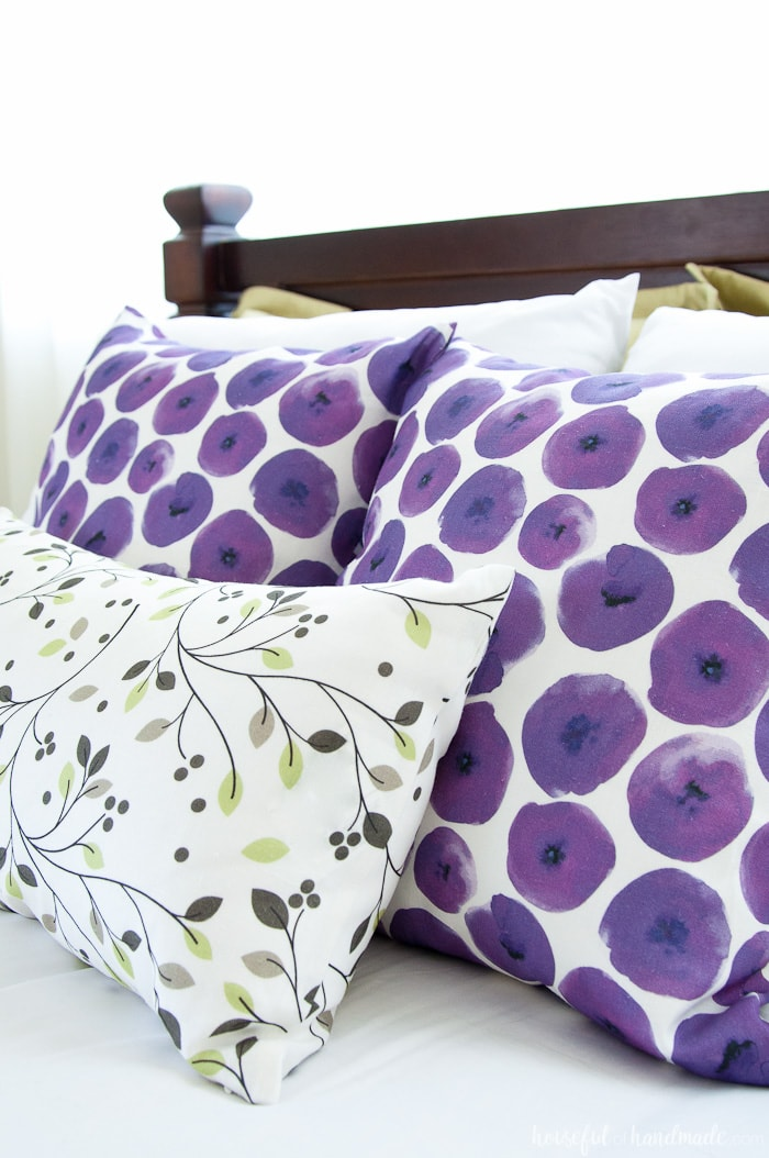 A pop of color is easy to add to your summer bedroom with beautiful throw pillows. Housefulofhandmade.com