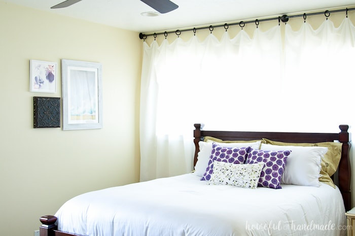 I love how these inexpensive curtains added so much light and style to this master bedroom. See the entire summer bedroom makeover here. Housefulofhandmade.com