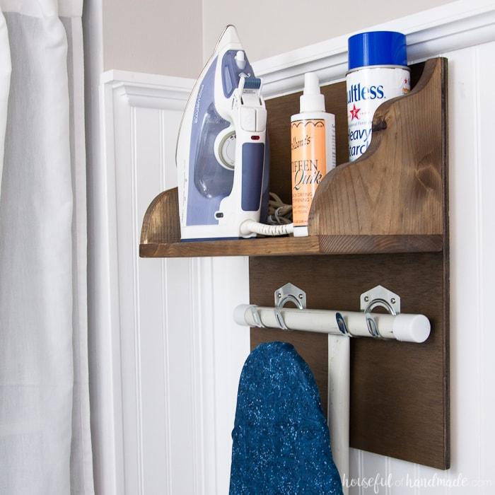 Use these amazing DIYs to Organize your home this year. Create the perfect place to store your iron and supplies. This easy DIY Iron Holder with Ironing Board Storage is a quick build that will keep your laundry room or craft room organized. Free build plans on Housefulofhandmade.com | Laundry Room Storage Ideas | Ironing Board Hanger | Iron Shelf | Things to Build with Scraps | $100 Room Challenge