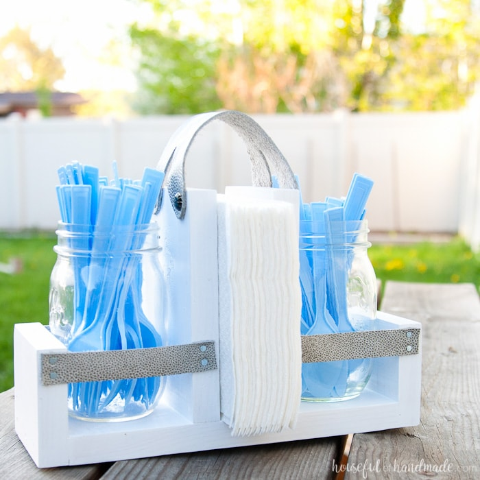 Get ready for summer BBQ season with this DIY utensil caddy with mason jars. It's perfect to hold everything you need for entertaining outside, it even has a spot to keep your napkins from blowing away. Super easy to build. Housefulofhandmade.com | Free build plans | 20 Minute Crafts | DIY Silverware Holder | Mason Jar Crafts | Scrap Wood Projects