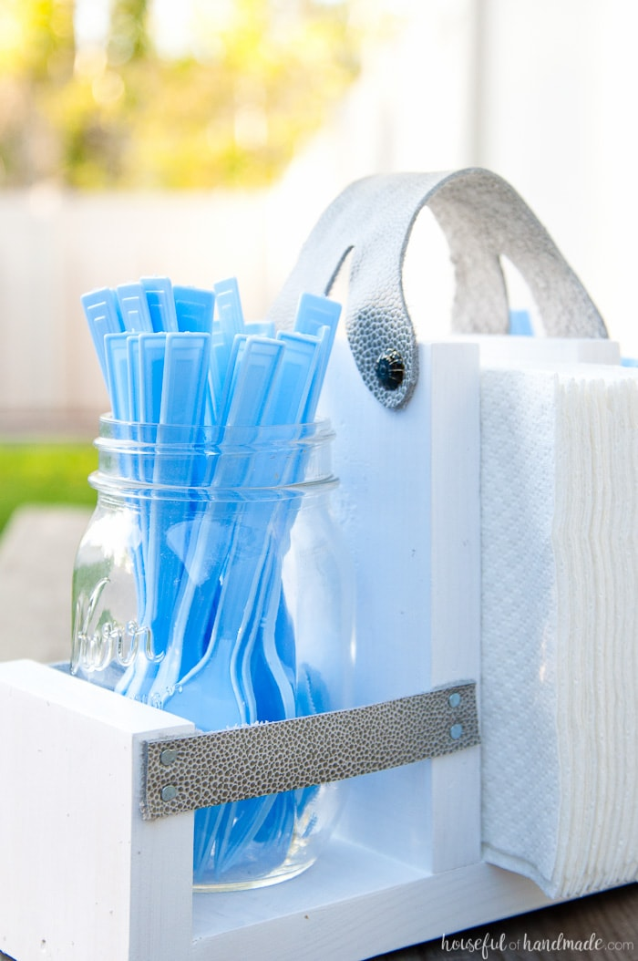 Get ready for summer BBQ season with this DIY utensil caddy with mason jars. It's perfect to hold everything you need for entertaining outside, it even has a spot to keep your napkins from blowing away. Super easy to build. Housefulofhandmade.com   Free build plans   20 Minute Crafts   DIY Silverware Holder   Mason Jar Crafts   Scrap Wood Projects