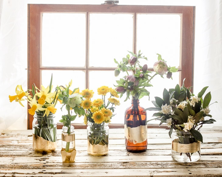 Ways to Upcycle Glass Jars & Bottles: DIY Gold Leaf Bottle Vases from Pretty Handy Girl.