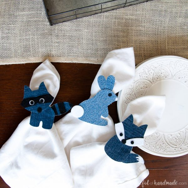 Create a fun, rustic table setting for spring with these Whimsical Spring Napkin Rings. Made out of recycled jeans, the denim woodland creatures make the perfect table accessory for Easter or Spring. Housefulofhandmade.com | Upcycled Denim | Spellbinders | Die Cutting | DIY Napkin Rings | Spring Table Setting Ideas | Paper Crafts | Steel Cut Dies