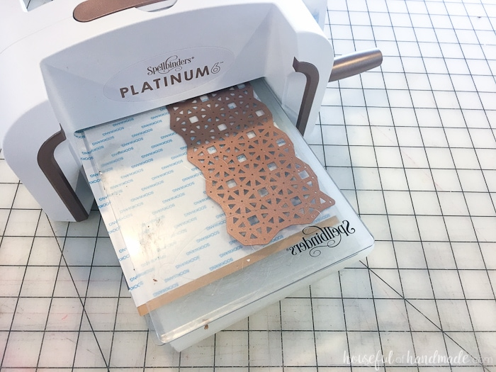 Add beautiful metal accents to a plain mirror. This DIY copper mirror is the perfect accent mirror for any room. Housefulofhandmade.com   DIY Home Decor   DIY Mirror Ideas   Copper Home Accents   Spellbinders