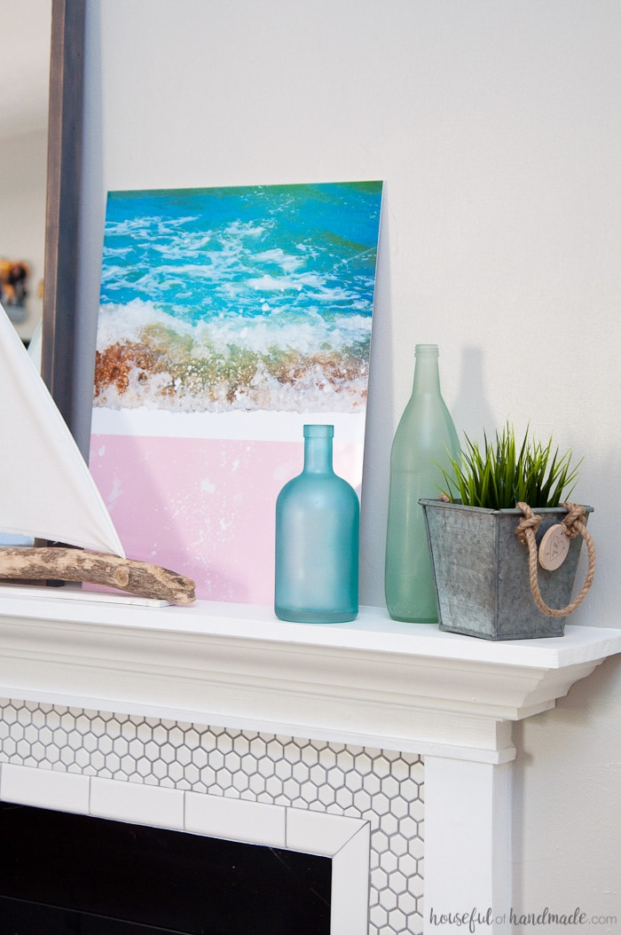 """Create the perfect summer mantel decor with """"found"""" beach objects. A DIY driftwood sailboat and mirror are the jumping off point for this soft beach house inspired summer mantel for the Decorate Your Mantel Series. Housefulofhandmade.com 