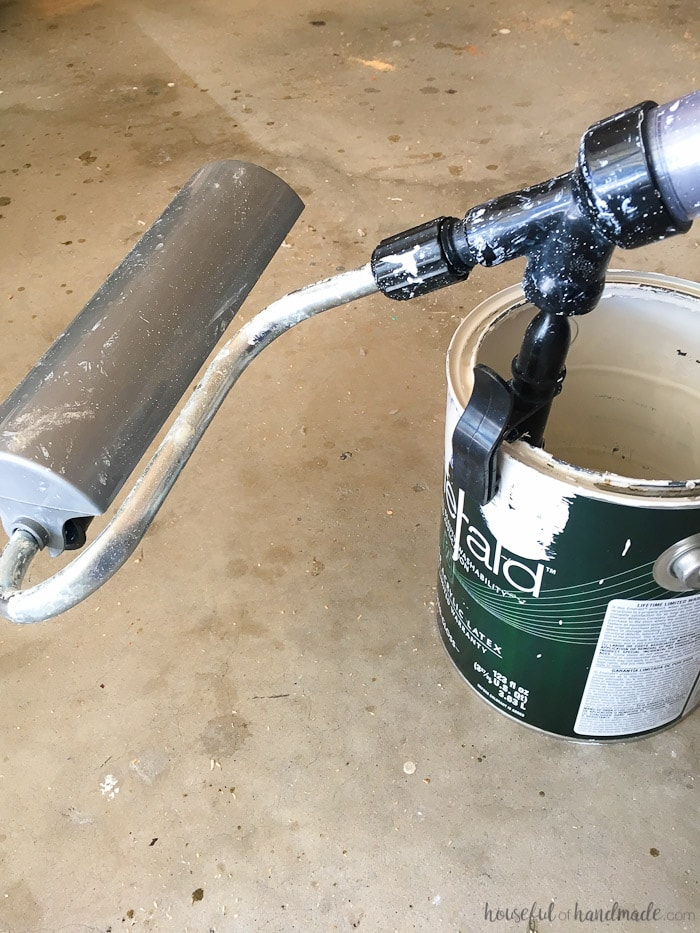 paint stick being used in paint can